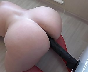 Chubby fuck hairy pussy with a big black dildo, doggystyle her fat butt shaking.